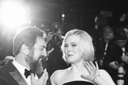 """Image was converted to black and white) (L-R) Javier Bardem and Elle Fanning pose at the """"The Roads Not Taken"""" premiere during the 70th Berlinale International Film Festival Berlin at Berlinale Palace on February 26, 2020 in Berlin, Germany."""