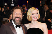 """(L-R) Javier Bardem and Elle Fanning pose at the """"The Roads Not Taken"""" premiere during the 70th Berlinale International Film Festival Berlin at Berlinale Palace on February 26, 2020 in Berlin, Germany."""