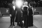 """Image was converted to black and white) (L-R) Javier Bardem, director Sally Potter, Elle Fanning and Salma Hayek pose at the """"The Roads Not Taken"""" premiere during the 70th Berlinale International Film Festival Berlin at Berlinale Palace on February 26, 2020 in Berlin, Germany."""