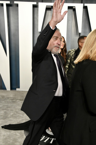 2020 Vanity Fair Oscar Party Hosted By Radhika Jones - Arrivals [suit,event,formal wear,gesture,hand,photography,dance,tuxedo,performance,radhika jones - arrivals,radhika jones,robert de niro,beverly hills,california,wallis annenberg center for the performing arts,oscar party,vanity fair,radhika jones,oscar party,vanity fair,party,92nd academy awards,academy award for best actor,celebrity,model,actor]