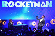 "Sir Elton John and Taron Egerton perform during the ""Rocketman"" Gala Party during the 72nd annual Cannes Film Festival on May 16, 2019 in Cannes, France."