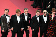 "Taron Egerton, Sir Elton John, David Furnish,  Kit Connor, Bernie Taupin and Bryce Dallas Howard attend the screening of ""Rocket Man"" during the 72nd annual Cannes Film Festival on May 16, 2019 in Cannes, France."