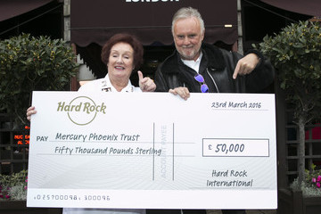 Roger Taylor Queen's Roger Taylor Accepts a Cheque For The Mercury Phoenix Trust