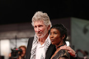 "Roger Waters and unknown guest walk the red carpet ahead of the ""Roger Waters Us + Them"" screening during the 76th Venice Film Festival at Sala Darsena on September 06, 2019 in Venice, Italy."