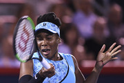 Venus Williams hits a return against Simona Halep of Romania during day four of the Rogers Cup at IGA Stadium on August 9, 2018 in Montreal, Quebec, Canada.
