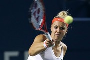 Sabine Lisicki of Germany plays a shot against Venus Williams of the USA during Day 1 of the Rogers Cup at the Aviva Centre on August 10, 2015 in Toronto, Ontario, Canada.