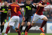 Edin Dzeko (R) of AS Roma competes for the ball with Leandro Greco (C) of Hellas Verona during the Serie A match between AS Roma and Hellas Verona FC  at Stadio Olimpico on January 17, 2016 in Rome, Italy.