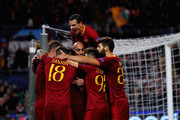 Edin Dzeko with his teammates of AS Roma celebrates after scoring the opening goal during the Group G match of the UEFA Champions League between AS Roma and CSKA Moscow at Stadio Olimpico on October 23, 2018 in Rome, Italy.