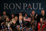 Republican presidential candidate, U.S. Rep. Ron Paul (R-TX) (C) and his wife Carol Paul (L) greet supporters during a rally on the night of the Iowa caucus at the Courtyard Des Moines Ankeny on January 3, 2012 in Ankeny, Iowa. According to early results U.S. Rep. Ron Paul (R-TX) came in third in the Iowa GOP caucus behind former Massachusetts Gov. Mitt Romney and former U.S. Sen. Rick Santorum, who were neck and neck.