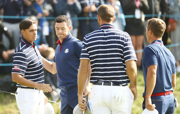 2018 Ryder Cup - Morning Fourball Matches [team sport,sports,player,ball game,championship,referee,competition event,coach,rickie fowler,dustin johnson,rory mcilroy,thorbjorn olesen,hands,united states,europe,le golf national,fourball matches,ryder cup]