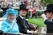 Queen Elizabeth II and Prince Philip, Duke of Edinburgh attend Day 3 of Royal Ascot at Ascot Racecourse on June 19, 2014 in Ascot, England.