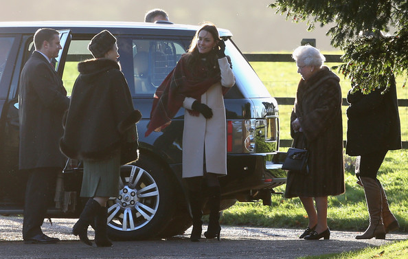 Queen Elizabeth II (2ndR), Catherine, Duchess of Cambridge (C) and Princess Anne, Princess Royal (2ndL) arrive at the Christmas Day service at Sandringham on December 25, 2013 in King's Lynn, England.