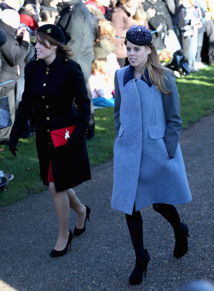 Princess Beatrice and Princess Eugenie arrive for the Christmas Day service at Sandringham on December 25, 2013 in King's Lynn, England.