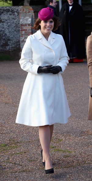 Princess Eugenie of York leaves the Christmas Day Service at Sandringham Church on December 25, 2014 in King's Lynn, England.