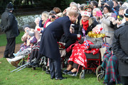 Prince Harry meets members of the public as he attends a Christmas Day church service at Sandringham on December 25, 2016 in King's Lynn, England.