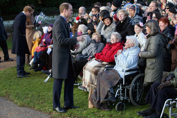 Prince William, Duke of Cambridge stops to chat to members of the public as he leaves the Christmas Day Service at Sandringham Church on December 25, 2014 in King's Lynn, England.