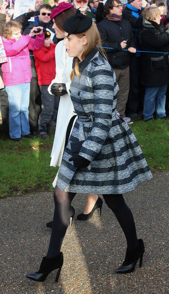 Princess Eugenie of York and Princess Beatrice of York arrive for the Christmas Day Service at Sandringham Church on December 25, 2014 in King's Lynn, England.