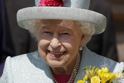Britain's Queen Elizabeth II smiles as she leaves after attending the Easter Mattins Service at St George's Chapel on April 21, 2019 in Windsor, England.
