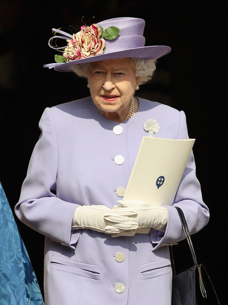 Queen Elizabeth II  leaves a thanksgiving service for a thanksgiving service for the Queen Mother and Princess Margaret at St George's Chapel on March 30, 2012 in Windsor, England.