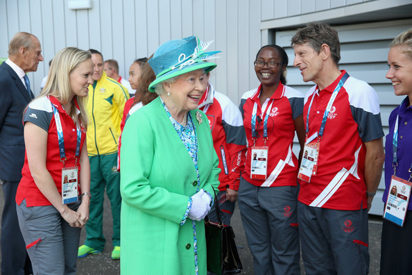 Queen Elizabeth II smiles as she meets volunteers at the Glasgow National Hockey Centre to watch the hockey during day one of 20th Commonwealth Games on July 24, 2014 in Glasgow, Scotland.