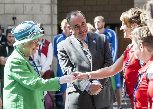 Queen Elizabeth II  is introduced to Games volunteers by Alex Salmond, Scotland's First Minister, as she and The Duke of Edinburgh visit the Tollcross International Swimming Centre during day one of the 20th Commonwealth Games on July 24, 2014 in Glasgow, Scotland.