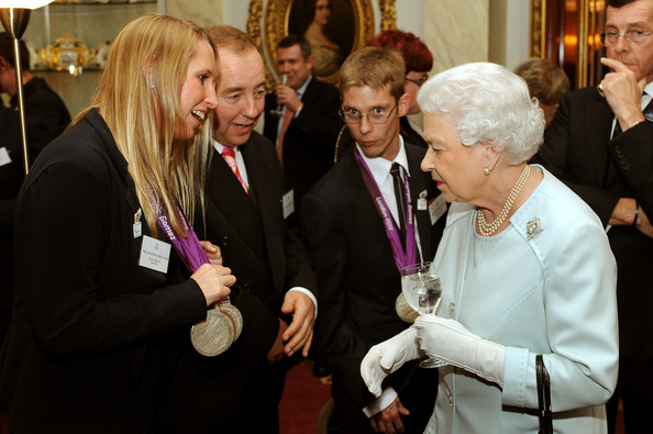 Queen Elizabeth II talks to Paralympic Swimmer Stephanie Millward (L), who wears six medals around her neck, during a reception held for Team GB Olympic and Paralympic London 2012 medalists at Buckingham Palace on October 23, 2012 in London, England.