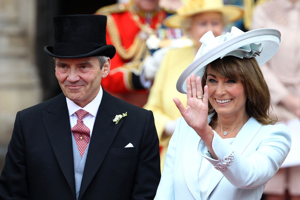 Michael and Carole Middleton smile and wave at the crowds following the marriage of Prince William, Duke of Cambridge and Catherine, Duchess of Cambridge at Westminster Abbey on April 29, 2011 in London, England. The marriage of the second in line to the British throne was led by the Archbishop of Canterbury and was attended by 1900 guests, including foreign Royal family members and heads of state. Thousands of well-wishers from around the world have also flocked to London to witness the spectacle and pageantry of the Royal Wedding.
