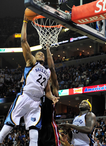 Rudy Gay #22 of the Memphis Grizzlies dunks over Chris Bosh #1 of the Miami ...
