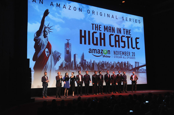 NY Premiere of Amazon Original's 'Man in the High Castle' [amazon originals man in the high castle,stage,event,display device,adaptation,advertising,stage equipment,projection screen,display advertising,performance,crowd,frank spotnitz,morgan wandell,rufus sewell,cary-hiroyuki tagawa,luke kleintank,alexa davalos,isa dick hackett,l-r,ny premiere]