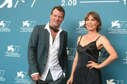"""Thomas Jane and Radha Mitchell attend the photocall of the movie """"Run Hide Fight"""" at the 77th Venice Film Festival on September 10, 2020 in Venice, Italy."""