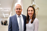 Brian Cashman and Rachel Goldman pose backstage as Runway Heroes Walk With The Yankees At Kleinfeld on June 18, 2019 in New York City.