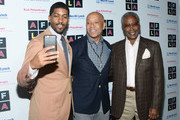 (L-R) Musician Fonzworth Bentley, host Russell Simmons and former professional wrestler Ed Lewis attend Russell Simmons' Rush Philanthropic Arts Foundation's inaugural Art For Life Los Angeles at Private Residence on May 3, 2016 in Los Angeles, California.