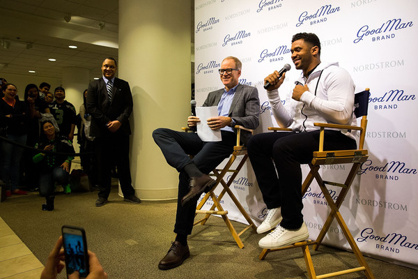 Russell Wilson Launches Good Man Brand at Nordstrom [nordstrom,russell wilson launches good man brand,seattle seahawks,event,yellow,job,design,news conference,adaptation,collaboration,businessperson,world,employment,seattle,washington,russell wilson,co-president,nordstrom pete nordstrom]