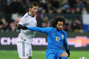 Fyodor Smolov of Russia vies for the ball with Marcelo of Brazil during the International friendly  match between Russia and Brazil at Luzhniki Stadium on March 23, 2018 in Moscow, Russia.