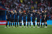 Mateo Kovacic holds his head dejected after missing his penalty as teammates look on from the half way line during the penalty shoot out during the 2018 FIFA World Cup Russia Quarter Final match between Russia and Croatia at Fisht Stadium on July 7, 2018 in Sochi, Russia.