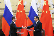 Chinese Premier Li Keqiang and Russian Prime Minister Dmitry Medvedev shake hands during a signing ceremony at the Great Hall of the People on November 1, 2017 in Beijing, China.