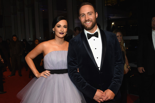 The 50th Annual CMA Awards - Arrivals [suit,formal wear,beauty,flooring,dress,fashion,tuxedo,carpet,gown,event,arrivals,kacey musgraves,ruston kelly,cma awards,nashville,tennessee,bridgestone arena]