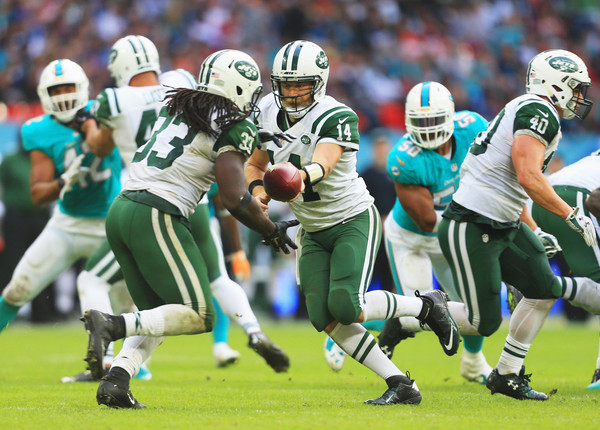 Miami Dolphins v New York Jets [player,sports,sports gear,helmet,tournament,american football,gridiron football,canadian football,sports equipment,team sport,ryan fitzpatrick,chris ivory,wembley stadium,england,london,new york jets,miami dolphins,game]