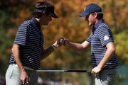 Bubba Watson (L) and Webb Simpson of the USA celebrate a birdie putt on the fifth green during day two of the Afternoon Four-Ball Matches for The 39th Ryder Cup at Medinah Country Club on September 29, 2012 in Medinah, Illinois.