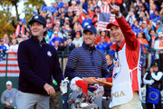 (L-R) Bubba Watson, Webb Simpson and caddie Ted Scott wait on the first tee during day two of the Morning Foursome Matches for The 39th Ryder Cup at Medinah Country Club on September 29, 2012 in Medinah, Illinois.