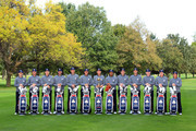 The USA team L-R: Zach Johnson, Webb Simpson, Jim Furyk, Bubba Watson, Matt Kuchar, Phil Mickelson, Davis Love II (Captain), Tiger Woods, Keegan Bradley, Dustin Johnson, Brandt Snedeker, Steve Stricker, Jason Dufner pose for an official photograph during the second preview day of The 39th Ryder Cup at Medinah Country Golf Club on September 25, 2012 in Medinah, Illinois.