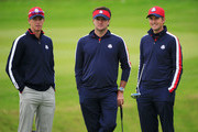 Bubba Watson (C) of the United States, his caddie Ted Scott and Webb Simpson (R) look on during practice ahead of the 2014 Ryder Cup on the PGA Centenary course at the Gleneagles Hotel on September 23, 2014 in Auchterarder, Scotland.