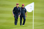 Keegan Bradley (L) and Phil Mickelson of the United States walk to the green during practice ahead of the 2014 Ryder Cup on the PGA Centenary course at the Gleneagles Hotel on September 23, 2014 in Auchterarder, Scotland.