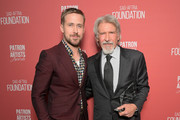 Ryan Gosling (L) and Artists Inspiration Award recipient Harrison Ford attend the SAG-AFTRA Foundation's 3rd Annual Patron of the Artists Awards at the Wallis Annenberg Center for the Performing Arts on November 8, 2018 in Beverly Hills, California.