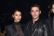 Model Sami Miro (L), in Saint Laurent by Hedi Slimane, and actor Zac Efron attend Saint Laurent at the Palladium on February 10, 2016 in Los Angeles, California for the Saint Laurent Los Angeles show.