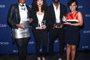 """Actors (L-R) .Aisha Hinds, Jurnee Smollett-Bell, Aldis Hodge and Amirah Vann pose with their Cast Award for """"Underground"""" backstage on Day One of aTVfest 2017 presented by SCAD at SCADshow Greenroom on February 2, 2017 in Atlanta, Georgia."""