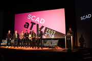 "(L-R) Marvin ""Krondon"" Jones III, James Remar, Damon Gupton, Christine Adams, China Anne McClain, Nafessa Williams, Cress Williams, and Salim Akil speak during a screening and Q&A for 'Black Lightning' on Day 3 of the SCAD aTVfest 2018 on February 3, 2018 in Atlanta, Georgia."