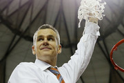 Head coach Billy Donovan of the Florida Gators celebrates by cutting down the net after their 61 to 60 win over the Kentucky Wildcats in the Championship game of the 2014 Men's SEC Basketball Tournament at Georgia Dome on March 16, 2014 in Atlanta, Georgia.