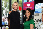 Maria Sharapova (L) and Editor-in-Chief of SELF Joyce Chang pose at a Q&A about being a SELF Made woman hosted by SELF Magazine September cover star Maria Sharapova and Editor-in-Chief Joyce Chang at Sugarpova Pop Up Store in the Andaz 5th Avenue on August 18, 2014 in New York City.