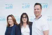 (L-R) Theresa Rebeck, Anjelica Huston and Jim Parrack arrive at the world premiere of the film 'Trouble' at Egyptian Theater, Seattle on June 7, 2017 in Seattle, Washington.